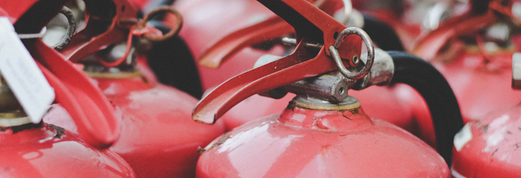 How often should fire extinguishers be serviced?